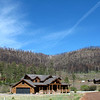 Greer home against the Wallow Fire damaged mountain.