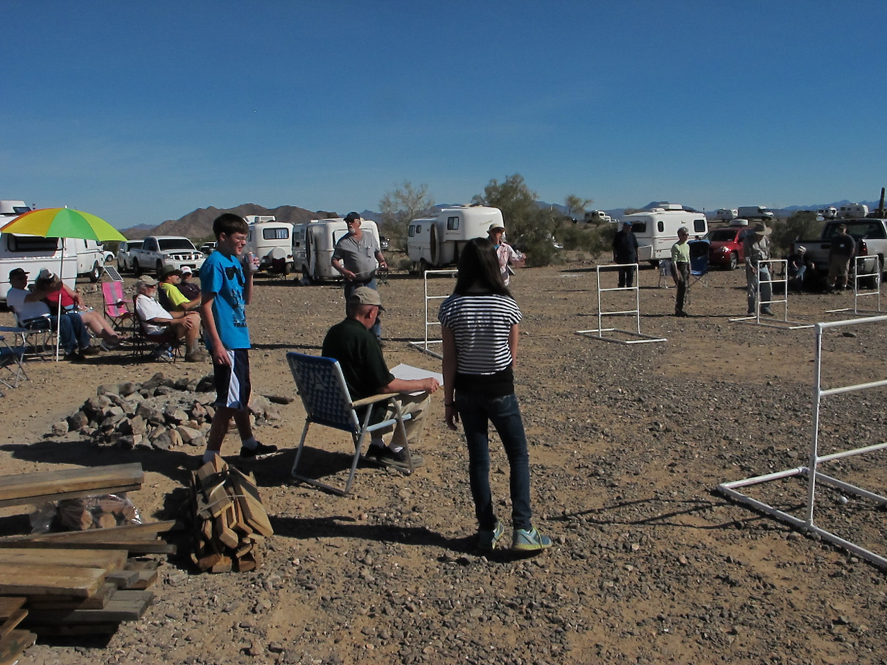 The Quartzsite kids help Earl. They've been coming to the Q Gathering for six years now. We've watched them grow up.