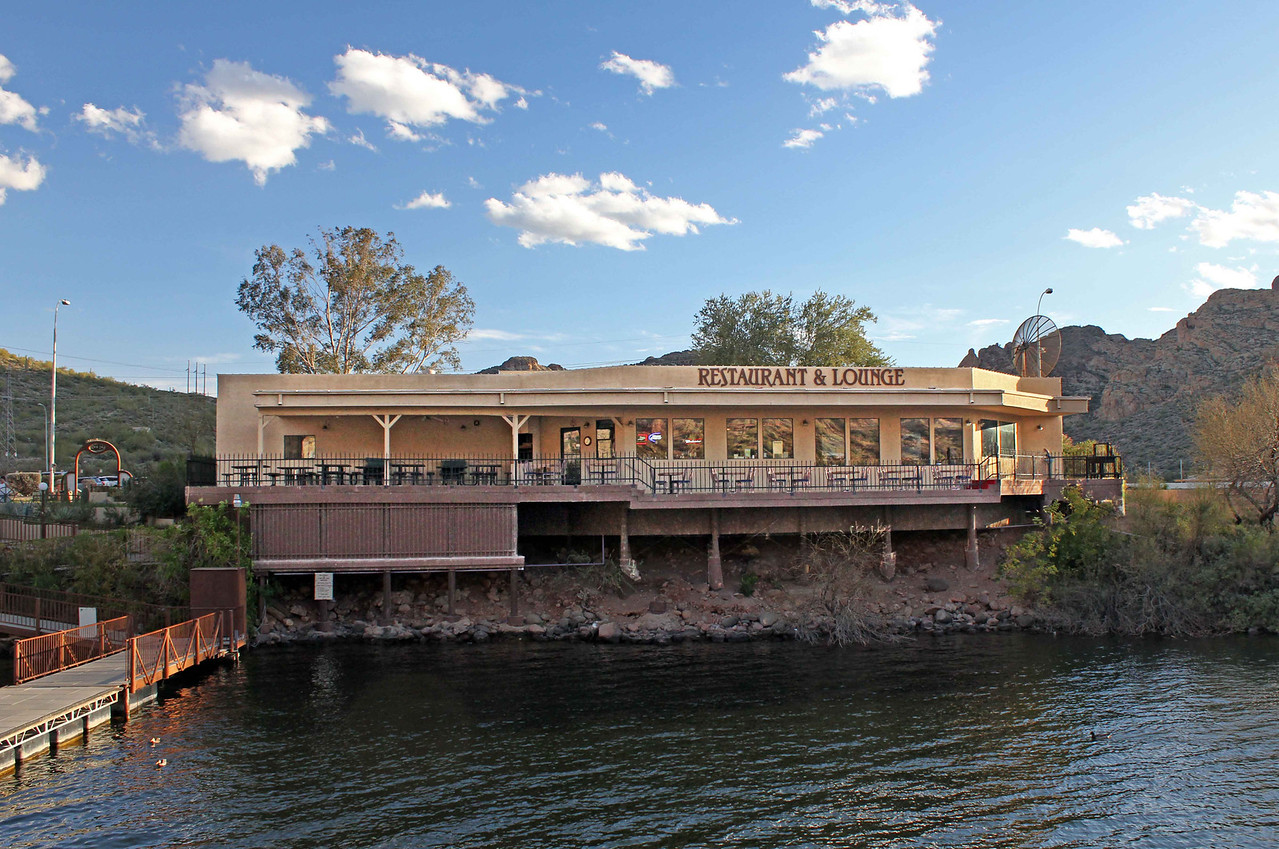 The Dolly ties up to the pier adjacent to the restaurant and lounge located at Canyon Lake.