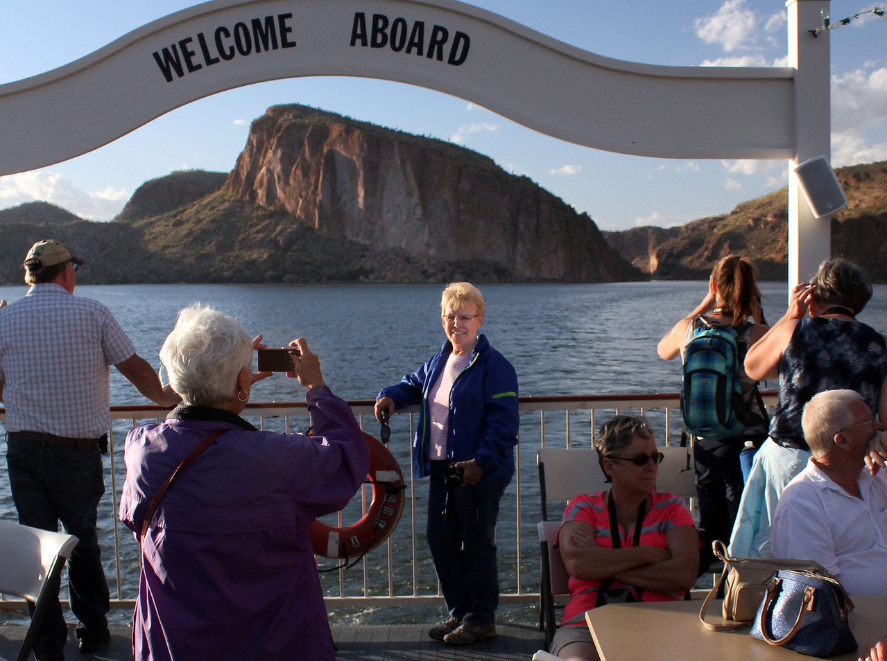 The final few minutes were busy, as most passenger raced to take their last few pictures aboard the Dolly.  Here, Belva Anderson takes a shot of Karen Miller with a terrific backdrop provided by Canyon Lake.