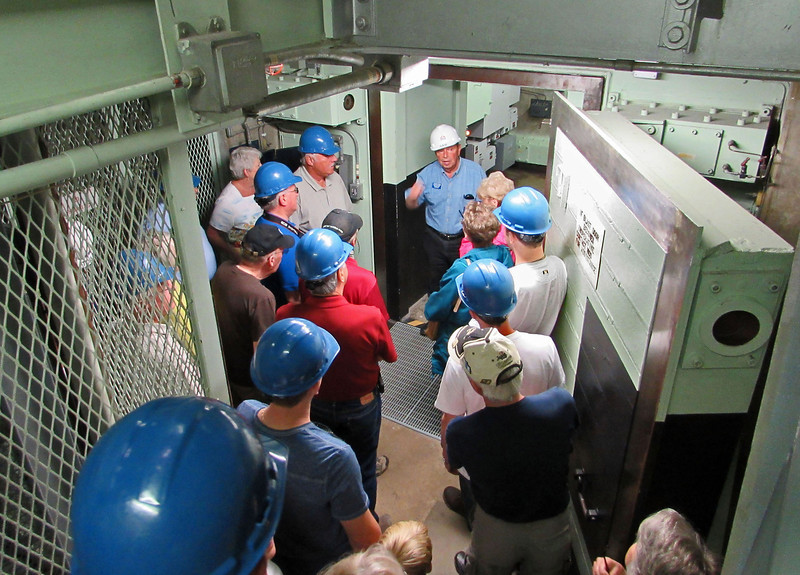 Sam Densler, identified by the white helmet, is a volunteer at the Titan Missile Museum.<br /> <br /> After descending to the Control Room level, he give us a quick lecture on safety and security within the area.
