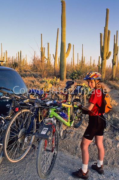 Biker on Hohokam Rd , west side of Saguaro NP in AZ - 48 - 72 ppi