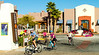 Cyclists exiting Lodge in Tucson, AZ - D1-C3-0016 - 72 ppi