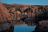 AZ 035                         The granite rock formations of Watson Lake glow in the twilight of a fading southwestern sunset.  Prescott, Arizona.