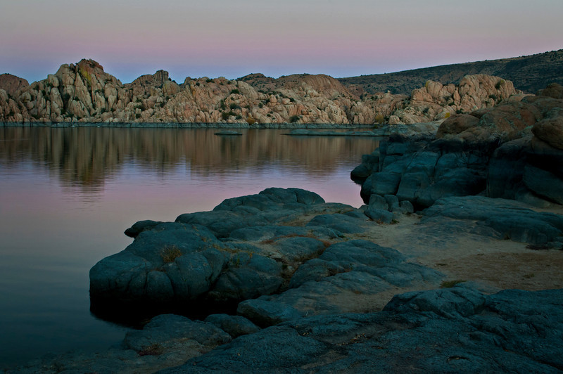 AZ 034                       The granite rock formations of Watson Lake glow in the twilight of a fading southwestern sunset.  Prescott, Arizona.