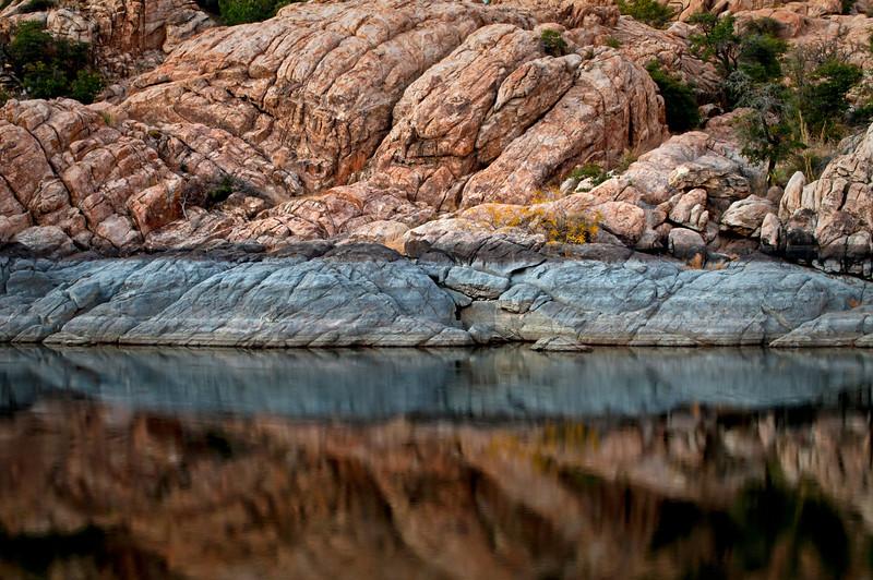 AZ 041                      Reflections of the granite shoreline of Watson Lake at sunset, Prescott, Arizona.