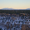 View of the Grand Canyon village with San Fransisco peaks near Flagstaff in the background