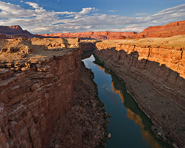 Marble Canyon Sunset - Echo Cliffs on horizon  upstream view from old Navajo Bridge, on Kaibab Ls, Permian