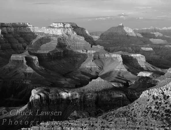 Grand Canyon National Park, AZ/Aug. The setting sun bathes the walls of the Grand Canyon landscape as seen from Mather Point, South Rim.