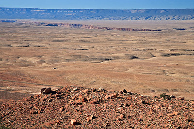 "View west from the Echo Cliffs monocline, across the Marble Platform The ""crack"" is the start of the Grand Canyon. Kaibab Plateau on the horizion"