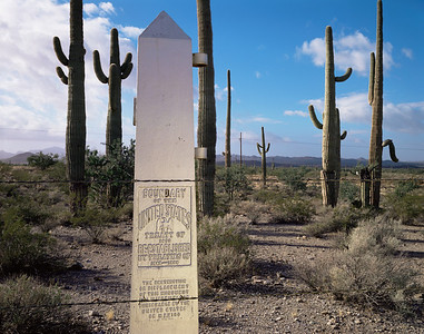 Organ Pipe Cactus, AZ/National Monument,Quitobaquito Springs, the Mexican border fence and boundary marker near the springs. 1290h add