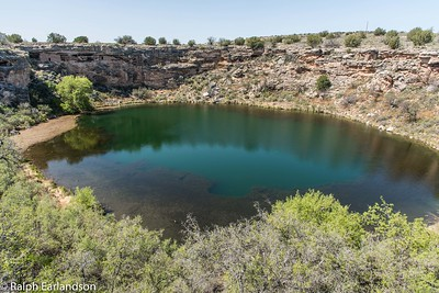 Montezuma's Well.  Note the cliff dwellings in the background.