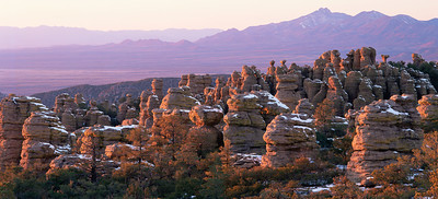 Chiricahua National Monument, AZ / The double summit of Dos Cabezas Mtns. etched in snow above the Sulphur Springs Valley, with spires of Chiricahua National Monument, foreground. 204P4
