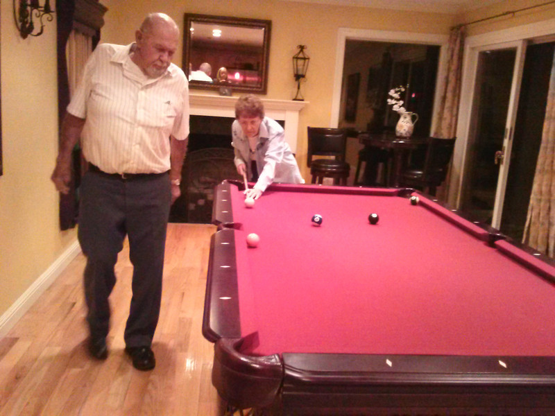 Mom learning to shoot pool<br /> (at brother David's house)