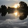Sunset over the basin, which is 4feet full of water after a rainstorm.  Love the clouds reflected in the water.