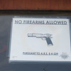 In AZ you can conceal and carry. Lots of restaurants, stores and public buildings have signs like this posted on their doors or windows..
