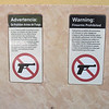 Arizona permits conceal and carry. You see these signs everywhere at the entrances to stores, restaurants, etc.