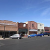 The business district, Safford AZ. This town is on Hwy 70. Agriculture - lots of irrigated flat farms land along the Gila River. And mining.