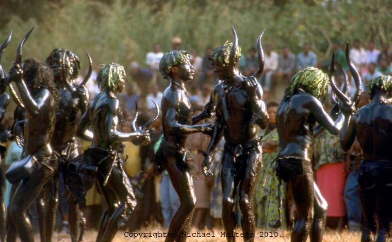 Dancers from a Fraternal Society of Hunters rest during a Special Fete of Initiation. Bafussam, Cameroon.