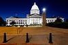 The Arkansas state capitol building illuminated at dusk in Little Rock, Arkansas, USA,