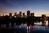 The Arkansas river and the city skyline of Little Rock Arkansas at dusk.