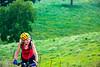 Biker on CR 2545, 6 miles south of Marble, ACA's Northwest Loop - C1_1C30056 - 72 ppi
