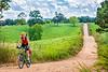 Biker on CR 2545, 6 miles south of Marble, ACA's Northwest Loop - C1_1C30059-Edit - 72 ppi