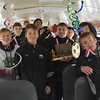 GREG SUKIENNIK -- MANCHESTER JOURNAL<br /> The Arlington Memorial High School boys' soccer team pose with their state Division 4 trophy while waiting for their victory parade to start on Saturday afternoon.
