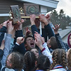GREG SUKIENNIK -- MANCHESTER JOURNAL<br /> The Arlington Memorial High School boys and girls soccer teams gather and lift up their trophies after arriving back at AMHS, following a parade through town. Both teams won Vermont Division 4 state titles on Saturday.
