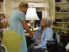 HOLLY PELCZYNSKI - BENNINGTON BANNER Colleen Blomberg, Junior at Arlington Memorial High school shares a moment with senior Virginia Mattison on Thursday morning at Equinox Terrace during a performance by the chorus students.