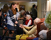 HOLLY PELCZYNSKI - BENNINGTON BANNER Kaylee Bushee, sophomore at Arlington Memorial High school shares a moment with senior Evelyn Pierce on Thursday morning at Equinox Terrace during a performance by the chorus students.