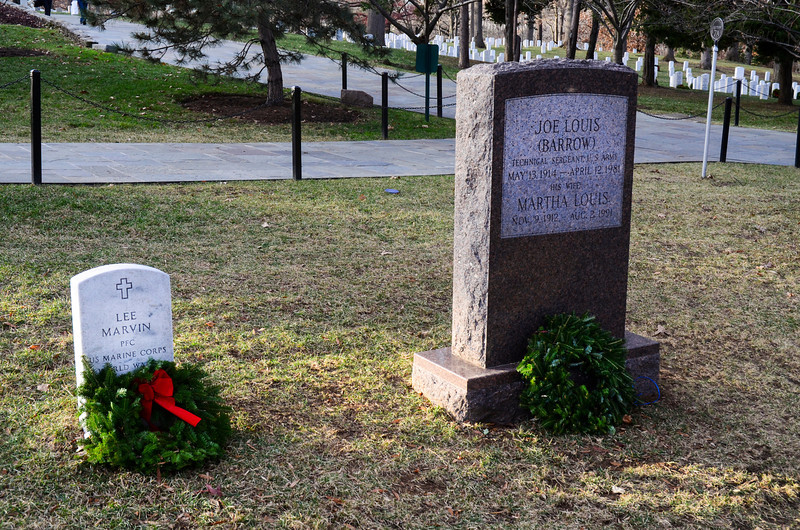 Film star Lee Marvin and boxing great Joe Louis lie side by side at Arlington National Cemetery. Holiday wreaths decorate graves at Arlington National Cemetery, December 2013.