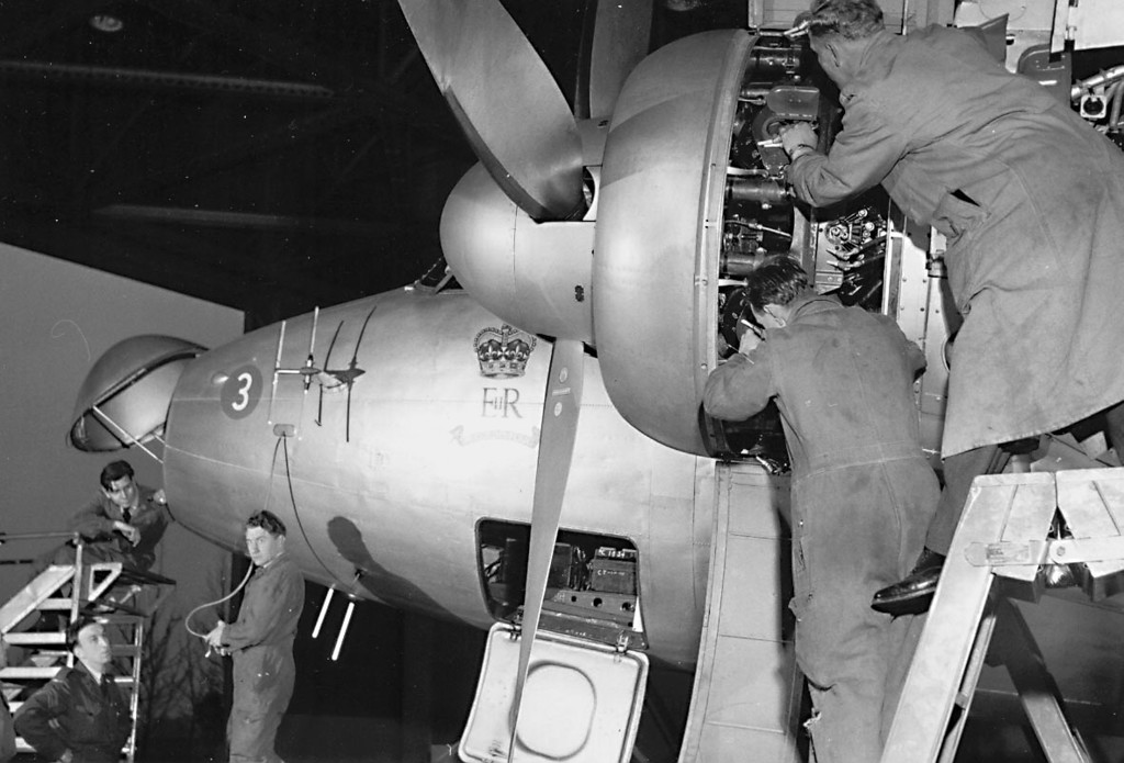 <font size=3><u> - Maintenance on a Vickers Viking aircraft of The Queen's Flight in D hangar. - </u></font> (BS0324)  From August 1946 until April 1958 both The King's and Queen's Flight operated a total of seven Vikings.  The first two Viking C1A aircraft used for Royal Flights (VL226 4th Oct 46 to 6th Feb 47 and VL227 27th Dec 46 to 6th Feb 47) were on loan from Vickers. VL245 a Mk C2 aircraft was acquired 11th Aug 46 and was used as a workshop aircraft by the Flight's ground crew.  This aircraft crashed at Aberdeen in Sept 47 and was disposed of in Jul 48.  The Viking aircraft received in 1947 were all Mk C2s.  Delivered in January 1947, VL246 was nominated as the King's aircraft, while VL247 was allocated to the Queen.  These aircraft remained in service till Apr 58; both aircraft were then sold to Tradair. VL247 assumed the role of the workshop aircraft until being sold in Nov 53. VL233 joined the flight in Jul 48 until Apr 58 then sold to Tradair. VL232 served from Jul 48 until Apr 57 before being sold to British Eagle.
