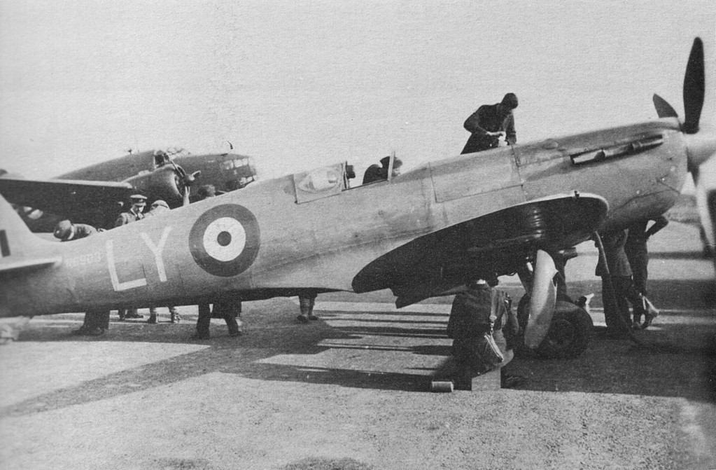<font size=3><u> Spitfire, Type R 6903 </u></font> (BS0323)  Spitfire, Type R 6903, being prepared for a Photographic Reconnaissance mission.  PO Gordon Green flew this aircraft on 1st mission to St Nazaire 13 Feb 1941 and mission during which Gneisnau and Scharnhorst were located in Brest 28 Mar 1941.