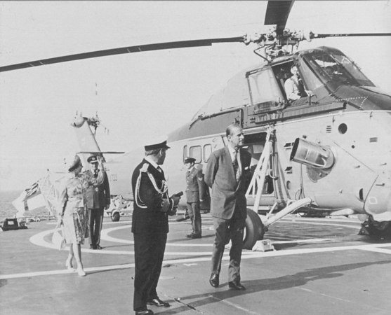 <font size=3><u> - Wessex HCC Mk4 - </u></font> (BS0359)  HM The Queen and HRH The Duke of Edinburgh on board HMS Fife returning from Hillsborough Castle during the Jubilee year of 1977.  On the 10th August 1977, HM The Queen and HRH The Duke of Edinburgh flew from the deck of HMS Fife to Hillsborough Castle in Wessex XV732, this was the first flight in a helicopter by the Queen.  The return flight from Hillsborough to HMS Fife on the 11th August was carried out by XV733 (the aircraft in the photo).  HMS Fife was the escort to the Royal Yacht (HMY Britannia).