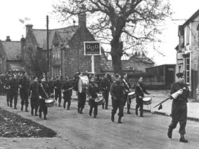 <font size=3><u> - Army Cadet Band - 1943/44 - </u></font> (BS0200)  Army Cadet Force on a Church Parade. The shed immediately left of the 3 Horseshoes is where pupils bikes were stored. The large building in the far distance between the pub and the school is Thames Villa on Littleworth Road.