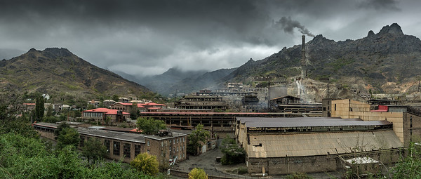 Panoramic view of the copper plant at Alaverdi, Armenia with heavy cloud and the mountains behind.