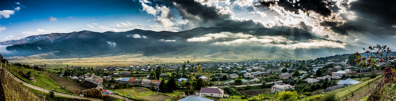 Panorama of a spectacular sunset over the town of Margahovit, in Lori Province, Armenia.