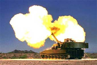 The M109A6 is self propelled 155 mm howitzer. It contains an on board ballistic computer and navigation system, secure radio communications, an improved cannon and gun mount, automatic gun positioning, automotive improvements and driver night vision equipment.