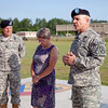 (FORT BENNING, Ga.) Col. Kevin S. MacWatters relinquishes command of the 194th Armored Brigade to Col. Scott D. King during a ceremony, June 25, 2013 at Brave Rifles Field. (Photo by Ashley Cross/MCoE PAO Photographer)