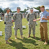 23 SEPT 2011 (FORT BENNING, GA) -  SPC Salah Al Hakim, president of BOSS (Better Opportunities For Single Soldiers), briefs three young soldiers at the BRAC to the Future celebration on York Field. Photo by Kristian Ogden.