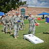 23 SEPT 2011 (FORT BENNING, GA) -  SGT Robert Richmond and SPC Christopher Jungnick from HUB 1/35 2nd BGD 1 DIV compete in a game of cornhole  at the BRAC to the Future celebration on York Field. Photo by Kristian Ogden.