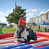23 SEPT 2011 (FORT BENNING, GA) -  Retired SFC Vickie Bailey attempts to master the art of bull riding in front of McGinnis-Wickam Hall at the BRAC to the Future celebration on York Field. Photo by Kristian Ogden.