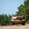 (FORT BENNING, Ga) Soldiers practice maneuver drills with the M1 Abrams Tuesday, July 10, 2012 at Fort Benning, Ga. (Photo by: Ashley Cross/MCoE PAO Photographer)