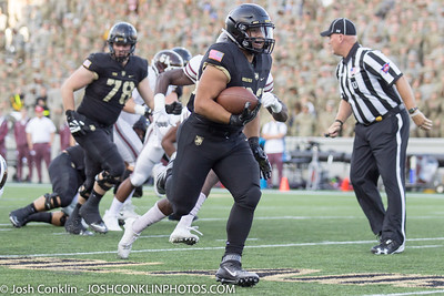 Army's Darnell Woolfolk runs in a touchdown during the 1st quarter at Michie Stadium in West Point, NY. Josh Conklin/For the Times Herald-Record