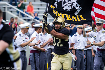 Army running back Artice Hobbs leads the team onto the field prior to the game against Liberty at Michie Stadium in West Point saturday. Josh Conklin/For The Times Herald-Record