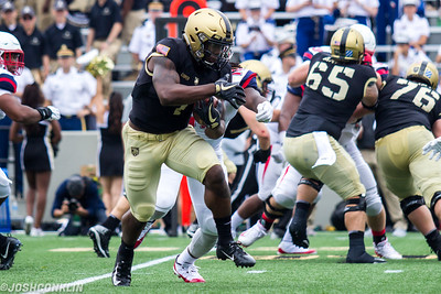 Army's Fred Cooper runs the ball through the defense during their game against Liberty at Michie Stadium in West Point saturday. Josh Conklin/For The Times Herald-Record