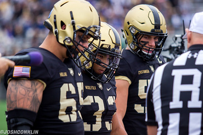 Army captains Bryce Holland, Darnell Woolfolk and Cole Christiansen during the coin toss before their game against Liberty at Michie Stadium in West Point saturday. Josh Conklin/For The Times Herald-Record