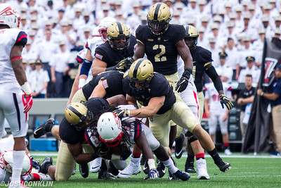 Army defenders Edriece Patterson (left) and Cole Christiansen (right) make a tackle against Liberty at Michie Stadium in West Point saturday. Josh Conklin/For The Times Herald-Record