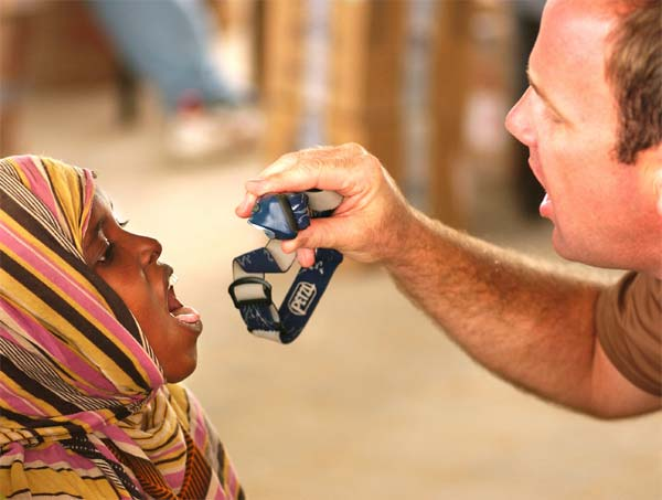 Master Sgt. Eric Loew, from Combined Joint Task Force-Horn of Africa, gives an Ethiopian child a medical checkup in the town of Gode, during a medical civic action mission.